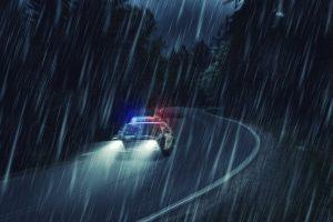 police car in rain